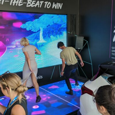 Woman and man play Kia Beat the Beat experiential marketing activation at the Australian Open.