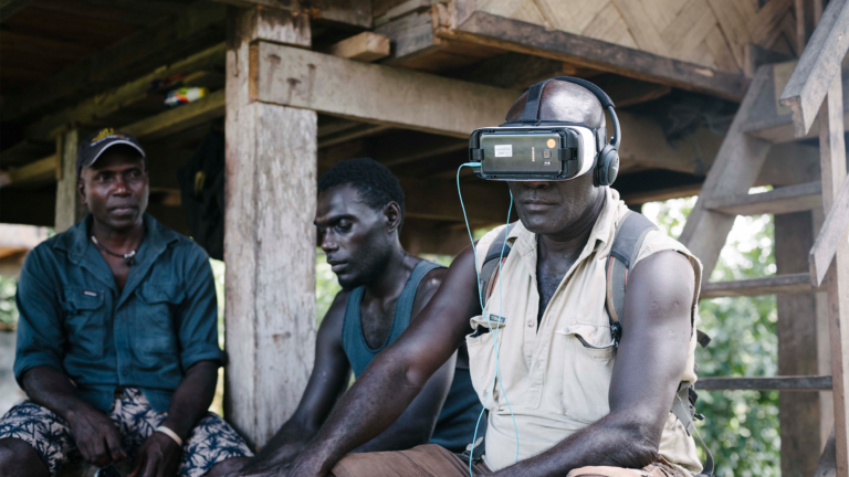 Man experiencing the virtual reality documentary.