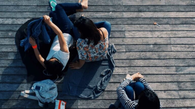 People Sitting on boardwalk.