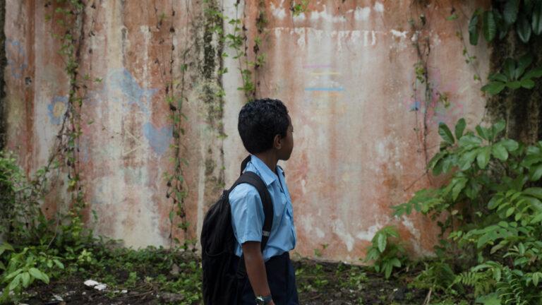 Fijian child in UNICEF Draw the Line TVC