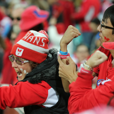 AFL fans wear interactive wristband from HCF Heart of the Swans data visualisation by experience studio S1T2.