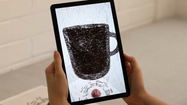 Tablet showing Nespresso AR augmented reality experience.