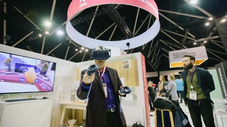 Man uses virtual reality to interact with Adobe Future of Retail Experience.