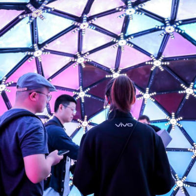 Three people experiment with the geodesic multicoloured LED dome for experiential marketing Take Me There.