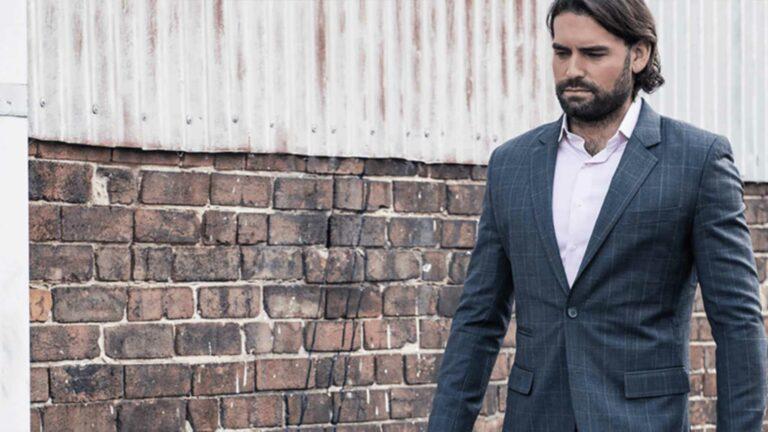 Slick male model wearing Brownmen&Co suit.
