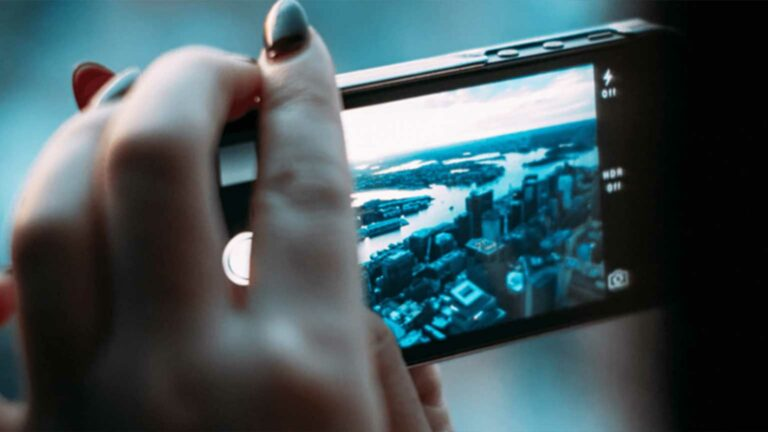 iPhone camera taking photo of city.