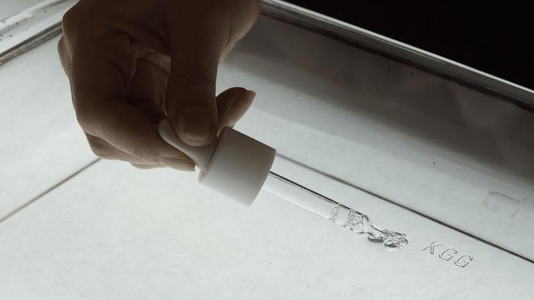 Dropper performing a creative ink experiment.